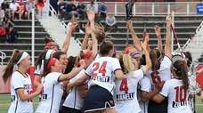 Stony Brook women's lacrosse celebrates after defeating Albany