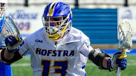 defends Hofstra's Ryan Tierney drives against LIU's Karl