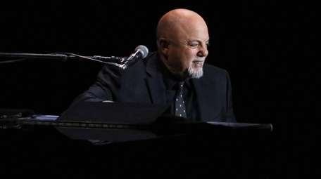 Billy Joel performs his residency show on stage