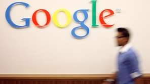 A visitor passes the Google logo at the
