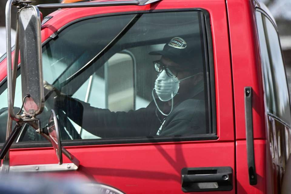 A truck driver wearing a mask in Jericho,