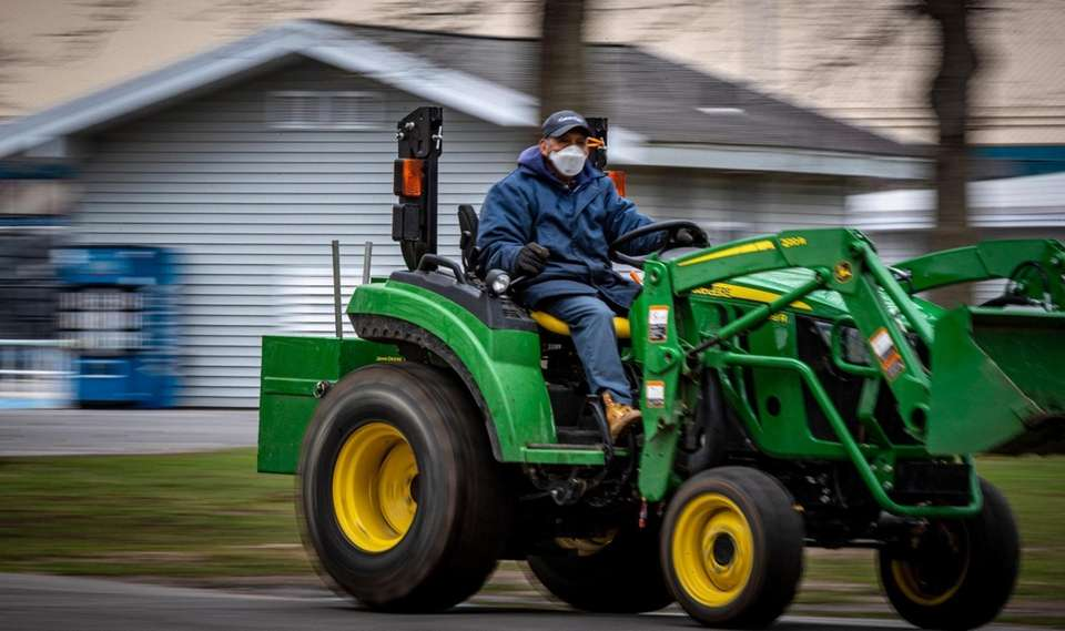 A county worker taken precautions while working at