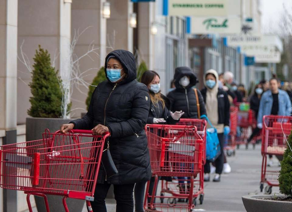 Shoppers exercise community spacing outside waiting to get