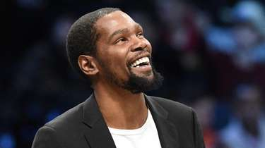 The Nets' Kevin Durant looks on against the