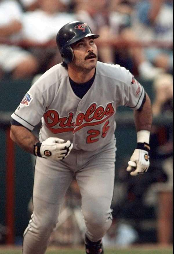 Baltimore Orioles' Rafael Palmeiro watches his solo home
