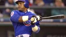 Chicago Cubs' Sammy Sosa watches his home run
