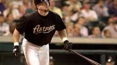 Houston Astros' Jeff Bagwell hits a solo home