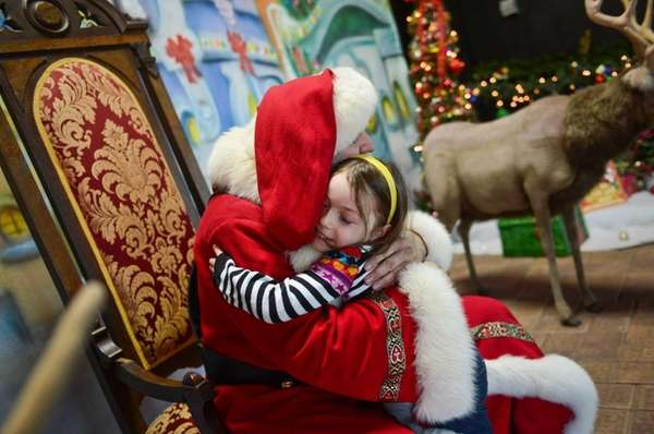 Lana Landa, 5, of Oceanside hugs Santa Claus
