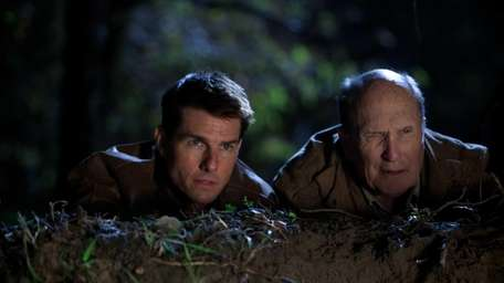 Tom Cruise, left, is Reacher and Robert Duvall