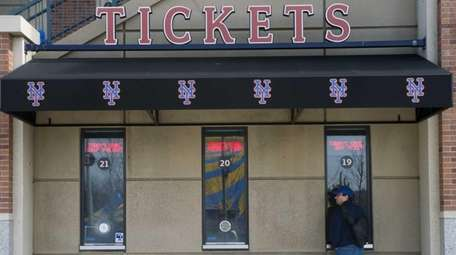 A Mets fan at the ticket window at