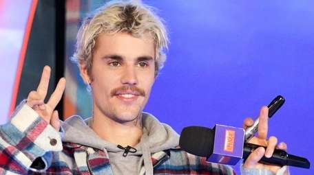 """Justin Bieber appears onstage during MTV's """"Fresh Out"""
