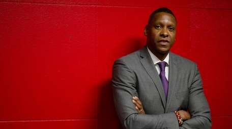Raptors president Masai Ujiri stands in the tunnel