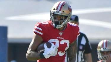 Levine Toilolo of the 49ers runs after catching