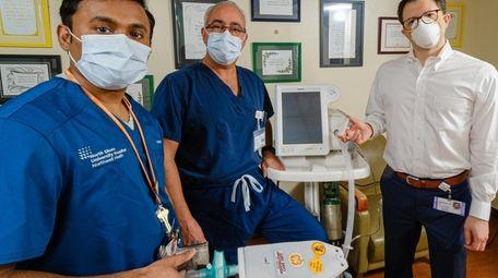 Dr. Stanley John, left, Dr. Hugh Cassiere, center,