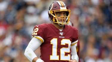 Redskins quarterback Colt McCoy stands on the field