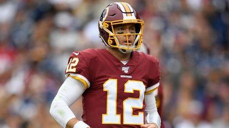 Redskins quarterback Colt McCoy stands on the field