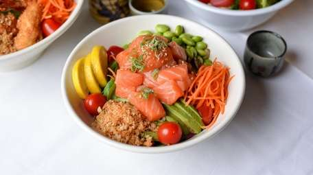A poke bowl with a base layer of
