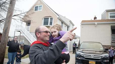 Callie Whaley and her father Billy Whaley wave