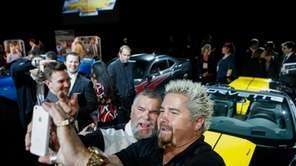 Guy Fieri (right), host of ?Diners, Drive-Ins and