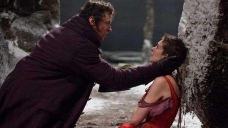 Hugh Jackman as Jean Valjean, left, and Anne