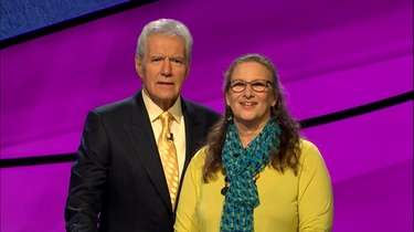 """Jeopardy!"" host Alex Trebek with Laura Mogul of"