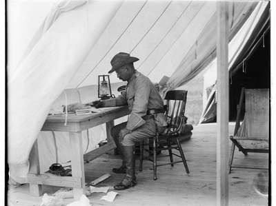 Theodore Roosevelt in his camp tent, Camp Wikoff,