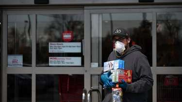 A man exits a Hicksville Target store with