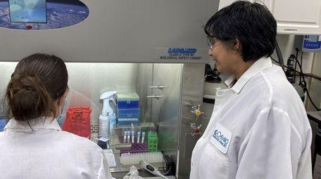 Chembio research and development director Dhammika Gunasekera, right,