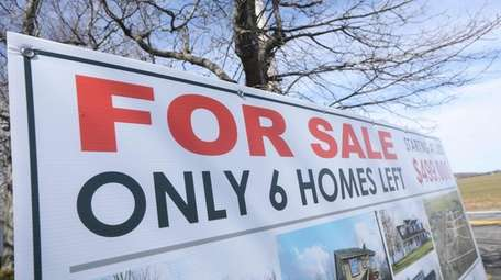 A for sale sign for 6 new homes