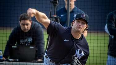 Yankees pitcher Gerrit Cole throws during spring training