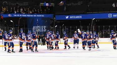 New York Islanders players celebrate their 2-1 win