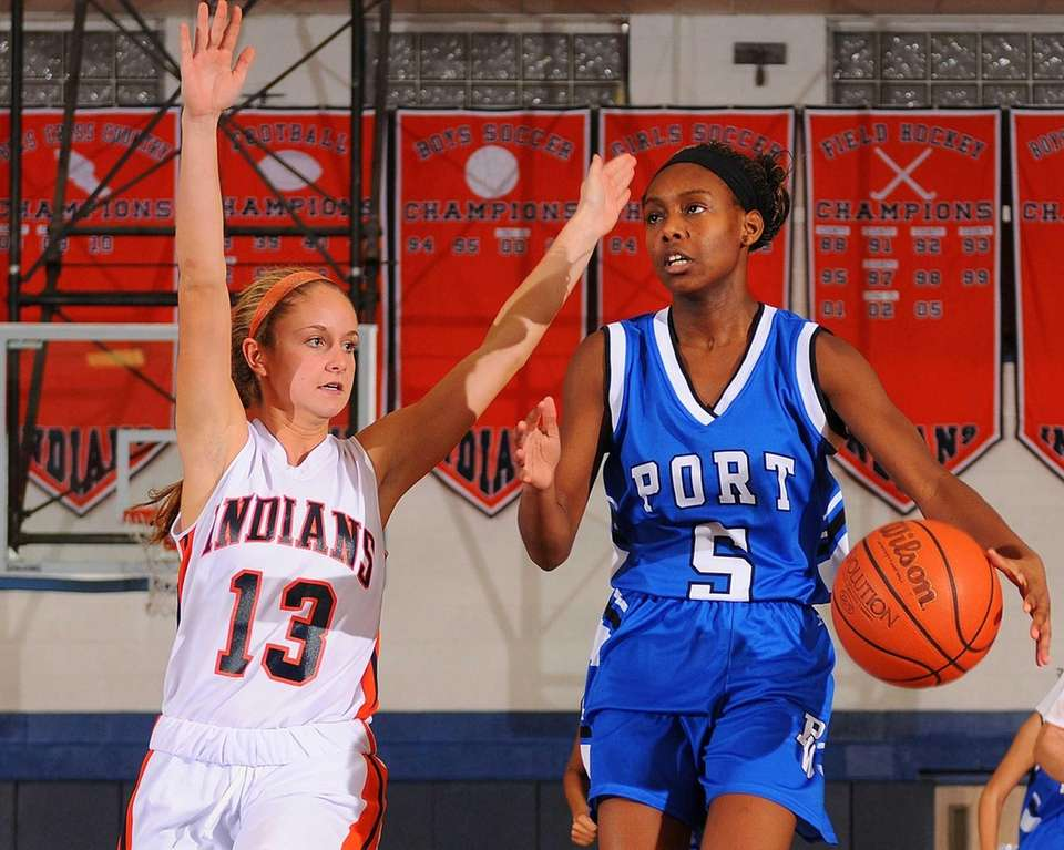 Port Washington's Mia Walker, right, gets pressured by