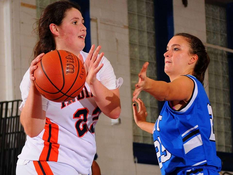 Manhasset's Katie Giesecke, left, looks to pass around