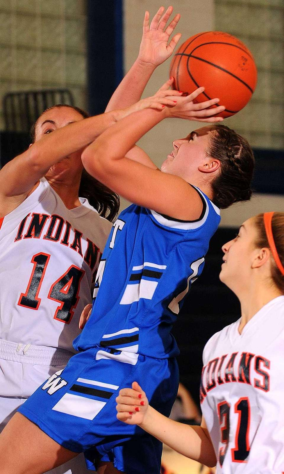 Port Washington's Megan Murphy draws a foul on