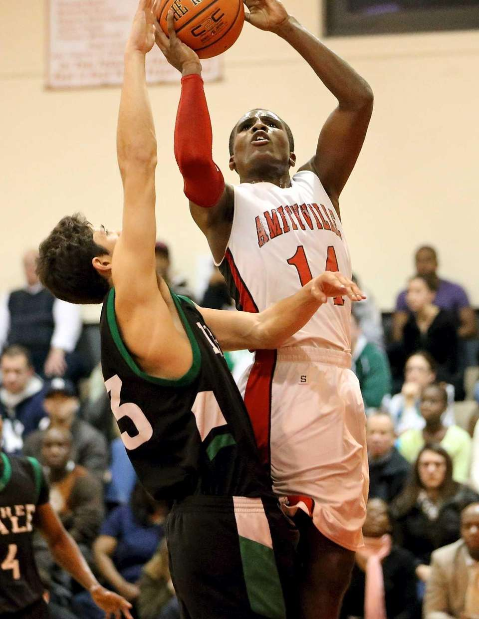 Amityville's Kavione Green goes up for a shot