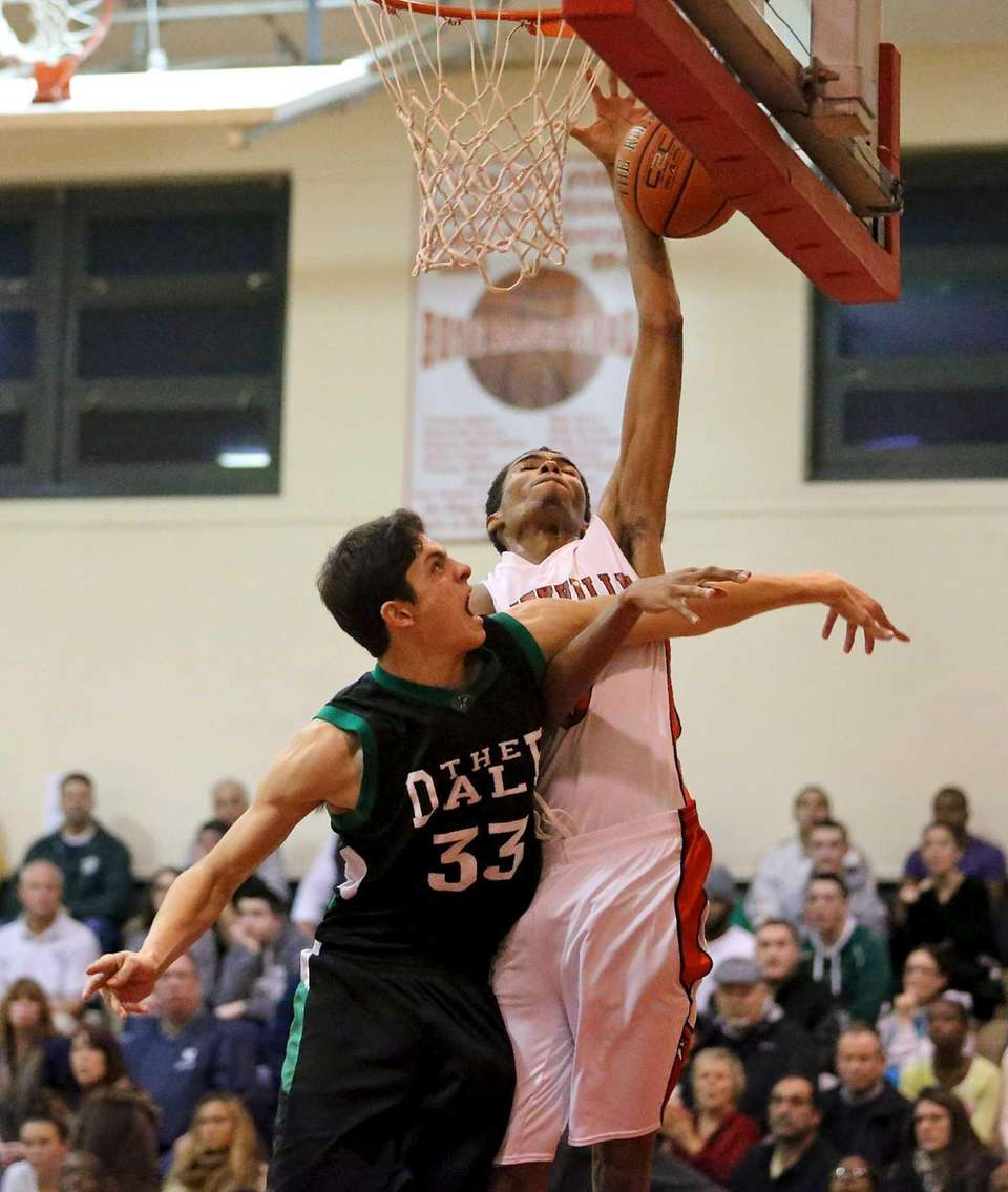 Amityville's Zack Tannis has his shot blocked by