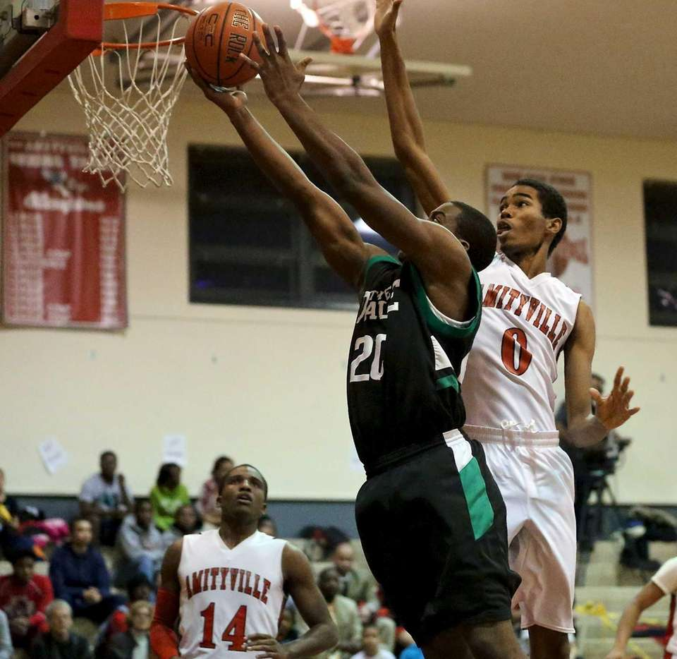 Farmingdale's Kevin Petit-Frere goes up for a shot
