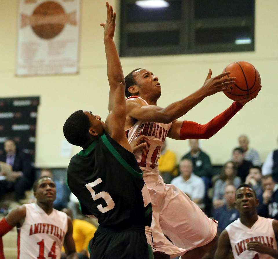 Amityville's Demetrius Chambers goes up for a layup