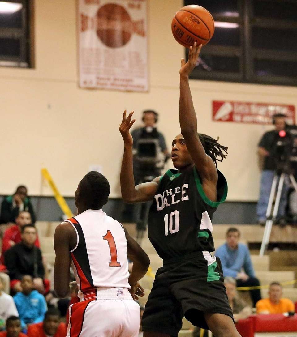 Farmingdale's Curtis Jenkins shoots over Amityville's Andy Laurent.