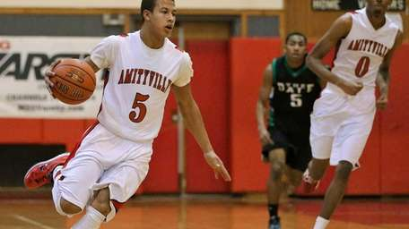 Amityville's Mike Smith pushes the ball upcourt during