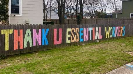 The Hlinko family in Islip colored their fence