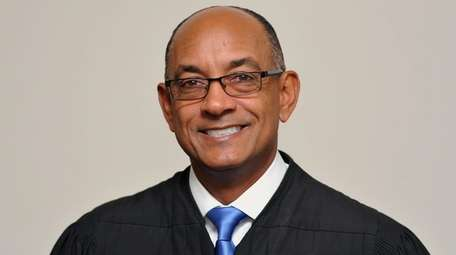 Nassau Administrative Judge Norman St. George poses for