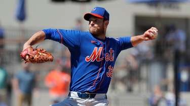 Mets pitcher Steven Matz throws during the first