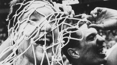 St. John's Chris Mullin has the net over