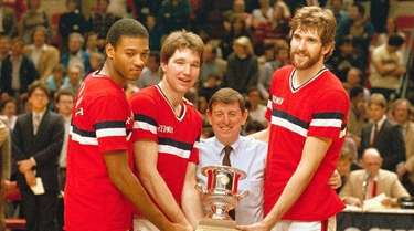 St. John's basketball coach Lou Carnesecca, center, flanked,