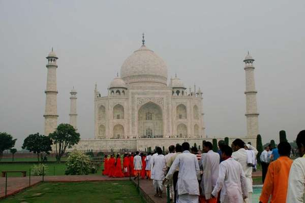 People gather at the Taj Mahal in India.