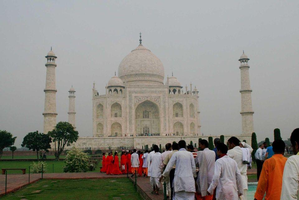 People gather at the Taj Mahal in India.