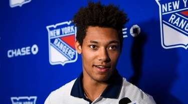 Rangers prospect K'Andre Miller speaks during a media