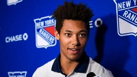 Rangers prospect K'Andre Miller speaks during a media