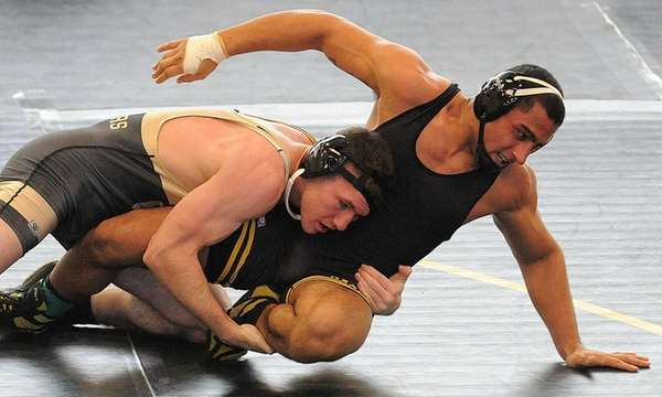 Wantagh's James Corbett, left, battles Giovanni Santiago of